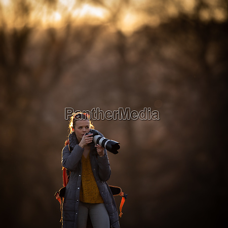 cute female photographer with her dslr