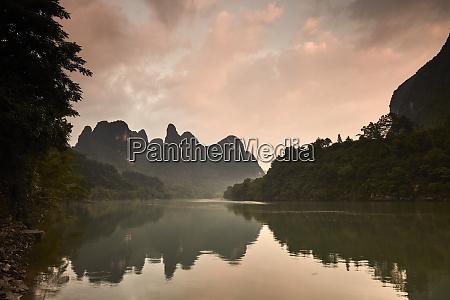 sunrise reflected in the li river