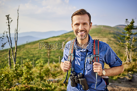 portrait of smiling man hiking in