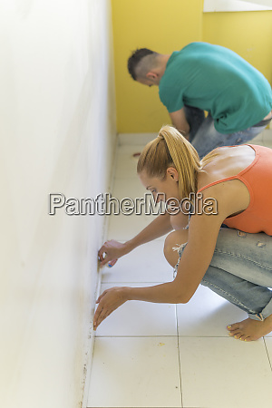 couple preparing room at new home
