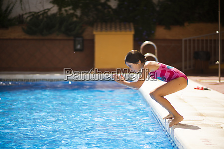 young girl jumping head first into