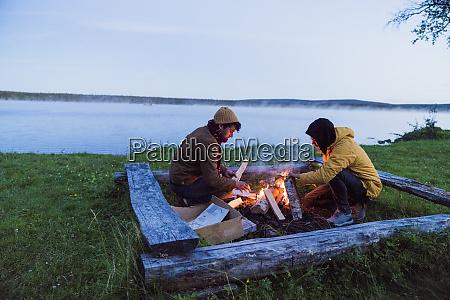sweden lapland two friends preparing a