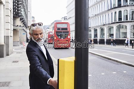 uk london bearded senior businessman pressing