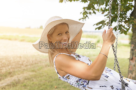 happy mature woman on swing in