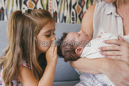 mother holding her baby close with