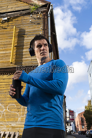 athlete in the city with headphones