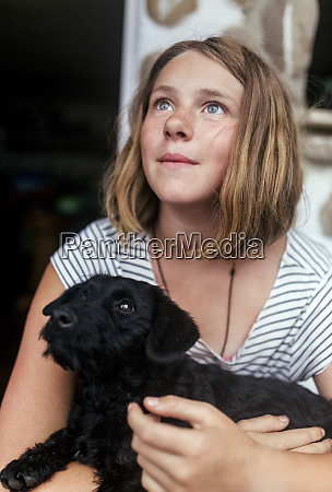portrait of freckled girl with black