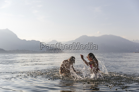 happy young couple playing in a