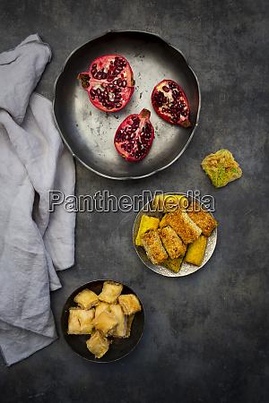 baklava shamiat and pomegranate in bowls