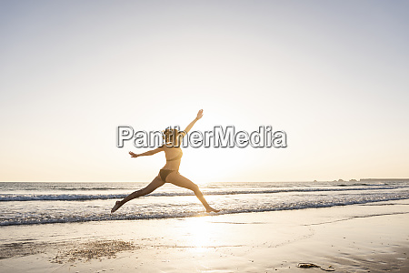 young woman jumping for joy on