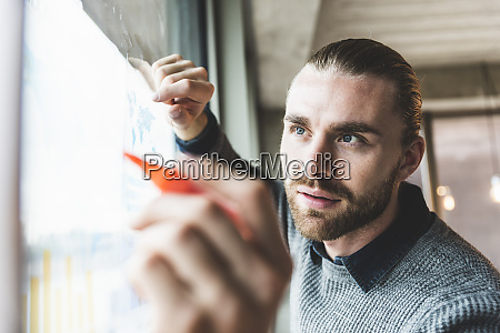 young businessman working on data at