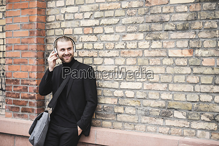 smiling fashionable young man with headphones