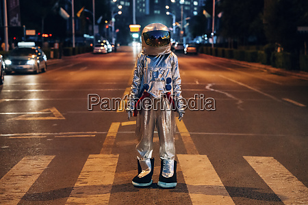 spaceman standing on a street in