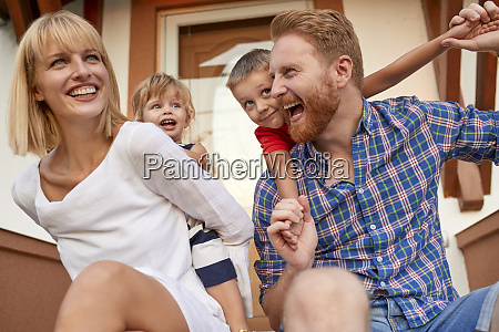 happy family on porch of their