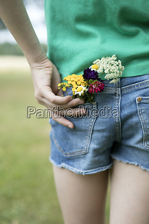 flowers in pocket of girls jeans