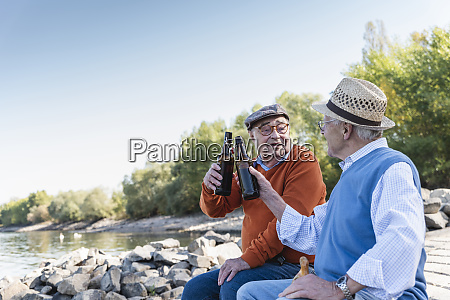 old friends sitting by the riverside