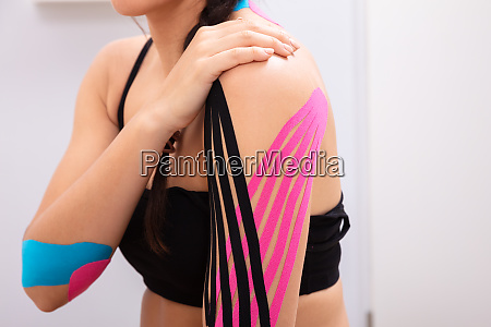 woman having physio therapy tape on