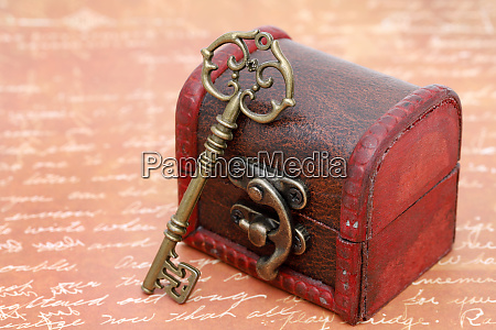 vintage key and old treasure chest