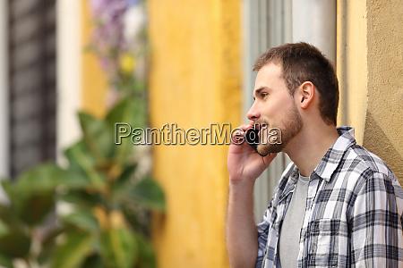 serious man having phone call in