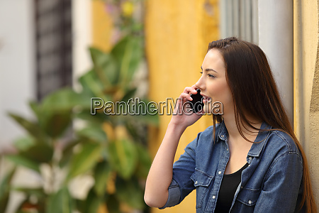 woman having phone call standing in