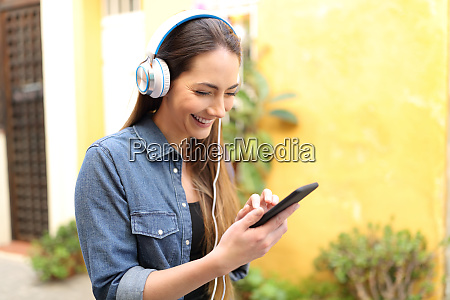 happy woman listening to music using