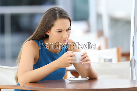 angry woman thinking in a coffee