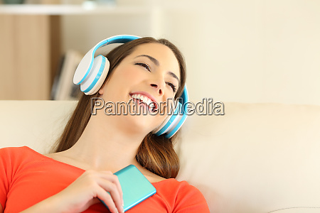 candid girl wearing headphones listening to