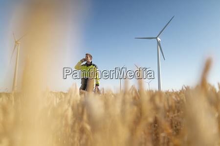 engineer standing in a field at