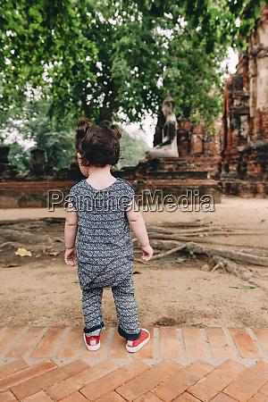 thailand ayutthaya baby girl exploring wat