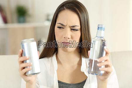 confused girl deciding between soda refreshment