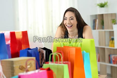 crazy shopper looking at several shopping