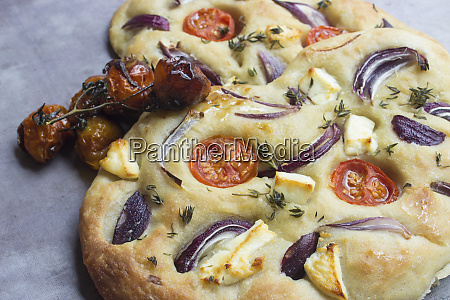 focaccia with tomatoes onions and cheese