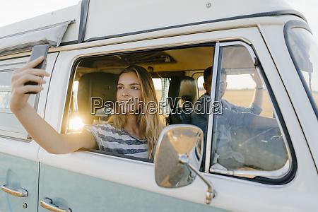smiling woman taking a selfie in