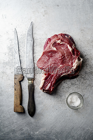 raw beef steak with a knife