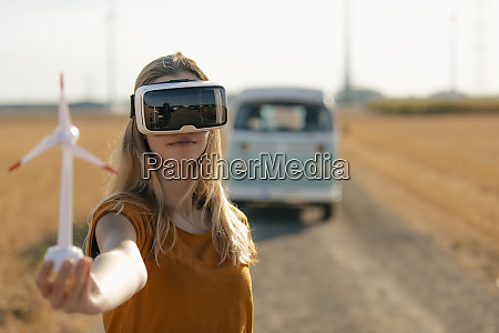 young woman with vr glasses at