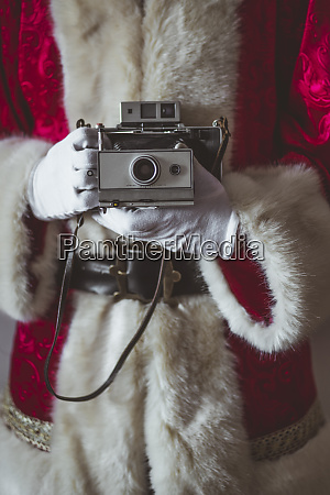 santa claus with vintage camera partial