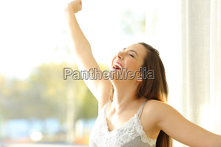 excited girl waking up in a
