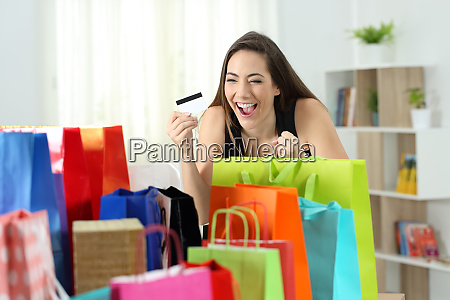 excited shopper looking at multiple purchases