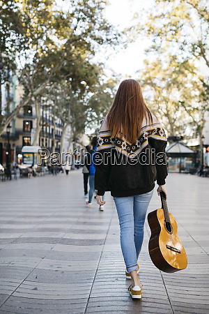 red haired girl with a guitar