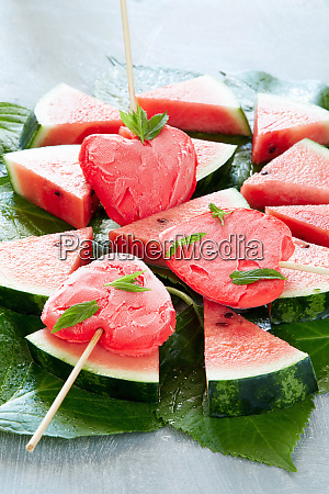 heart shaped watermelon popsicles on slices