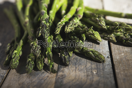 fresh green asparagus on a wooden
