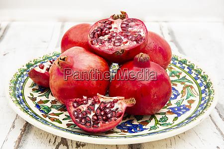 pomegranates whole and cut open