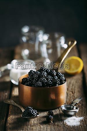 preparing blackberries jam