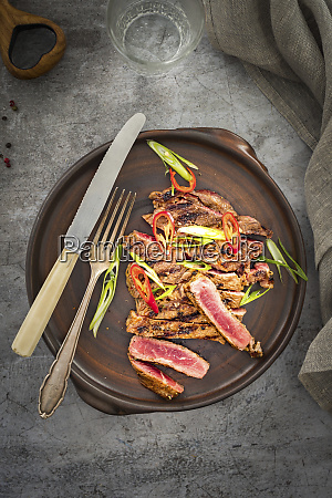 a grilled beefsteak sprinkled with chilli