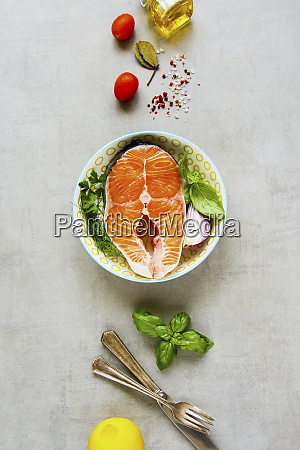 uncooked salmon steak and ingredients for