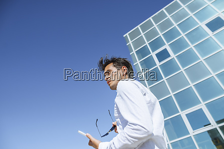 businessman with tablet and sunglasses outside