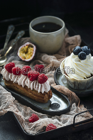 eclair with berries and cream and