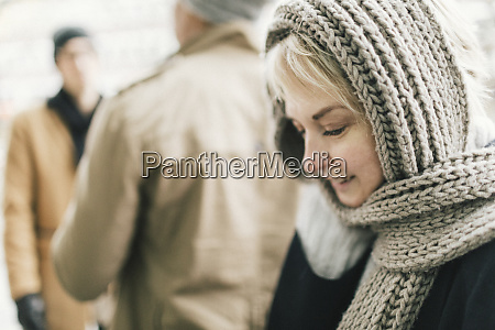 smiling blond woman covered with knitted