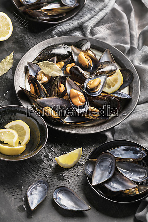 tasty baked mussels served with lemon