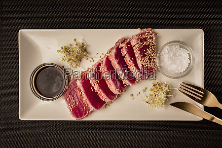 tuna steak served with soy sauce